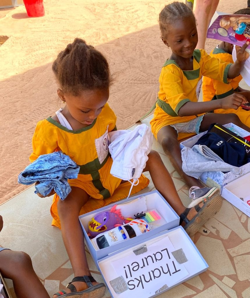 Girl receiving giftbox in The Gambia