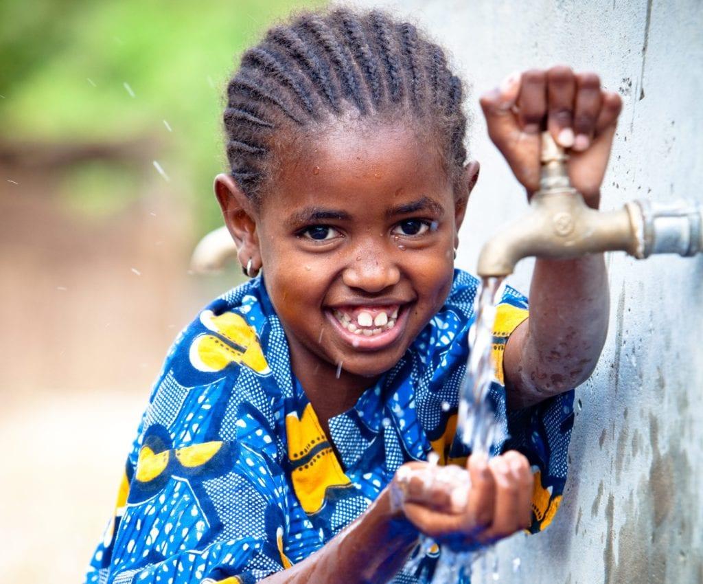 Girl enjoying clean drinking water