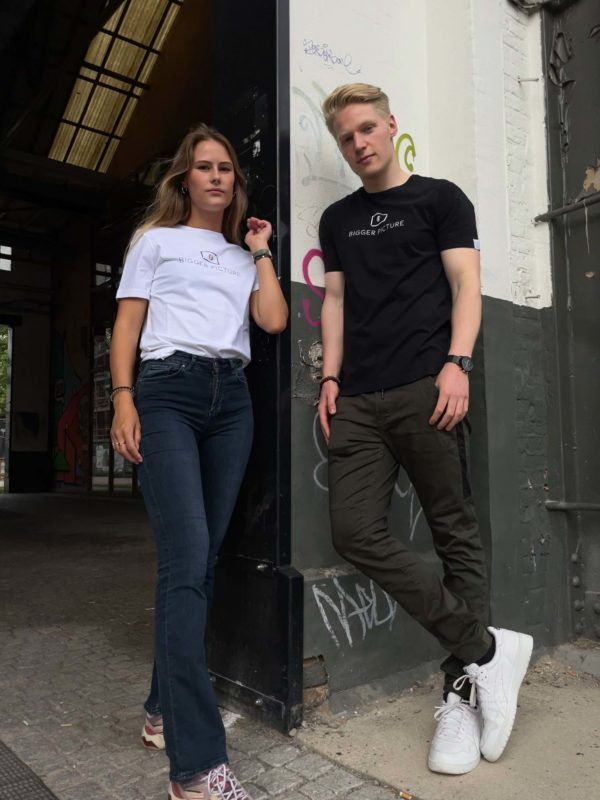 Freek and Pleun wearing the black & white unisex essential Tee from the ethical fashion brand Bigger Picture Clothing in Tilburg, the Netherlands.