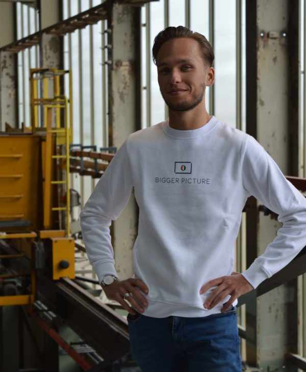 Thijmen wearing Bigger Picture Clothing's white sweater that is made from 100% organic cotton, in order to be environmentally-friendly and care for the planet.