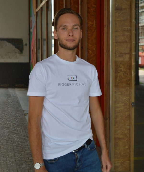 Thijmen wearing our White Essential Tee from the first collection of Bigger Picture Clothing, a social and sustainable fashion brand that wants to change the world.