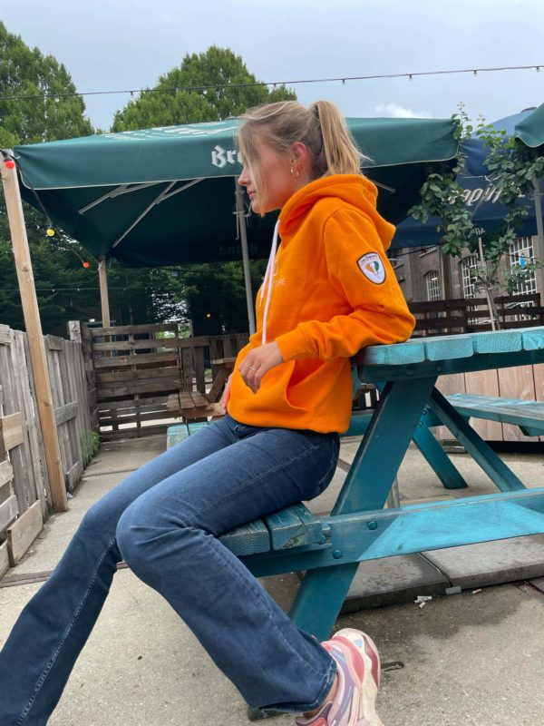 Pleun wearing our Original Orange hoodie that is made from 100% organic cotton and is part of Bigger Picture's Côte d'Ivoire collection.