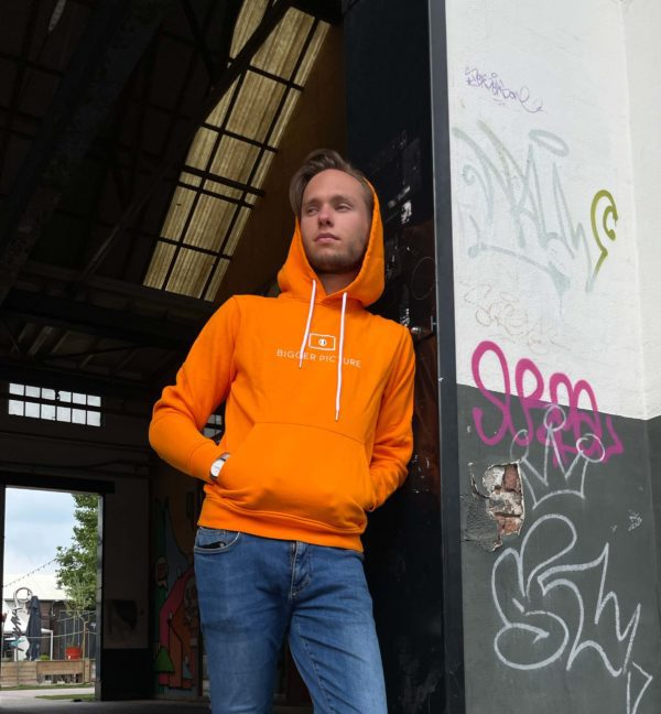Thijmen wearing our original orange hoodie which is sustainable produced in Portugal and which is part of Bigger Picture Clothing their first collection.