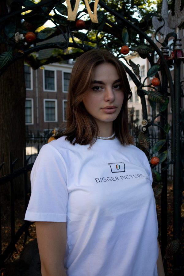 Dione wearing our white essential Tee, with which Côte d'Ivoire is supported.