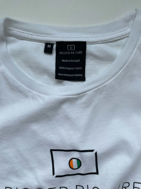 The neck label of our white essential Tee that states that this product is made from 100% organic cotton, produced in Portugal and that is more than just a piece of clothing.